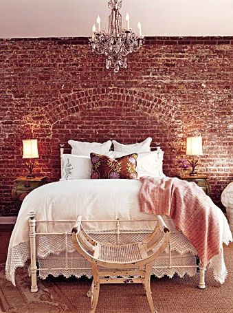 We love the exposed brick giving a pop of 2015's Pantone Color of the Year, Marsala.