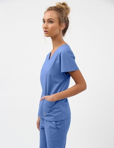 """Timeless V-Neck top features dolman sleeves, large front pockets and an additional hidden small pocket for extra storage. Dainty shape hides imperfections and hits at a more flattering point of the arm. Softens a strong shoulder line and strengthens a weaker one. Back length: 22""""."""