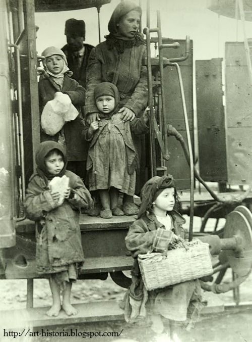 One of the numberless peasant families looking for luck in Bucharest (1929)  photograph by Nicolae Ionescu (1903-1975) source