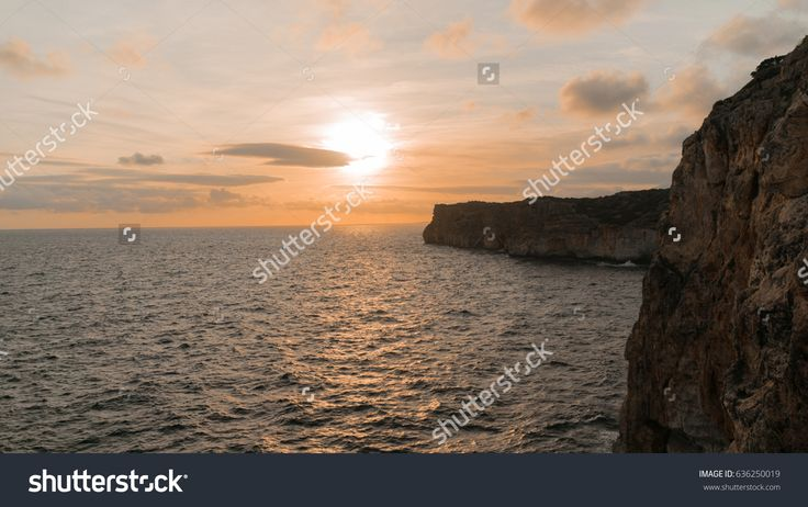 A sunset fromCova d'en Xoroi. This placeis a natural cave placed in Cala en Porter. Menorca, Balearic Islands. Spain