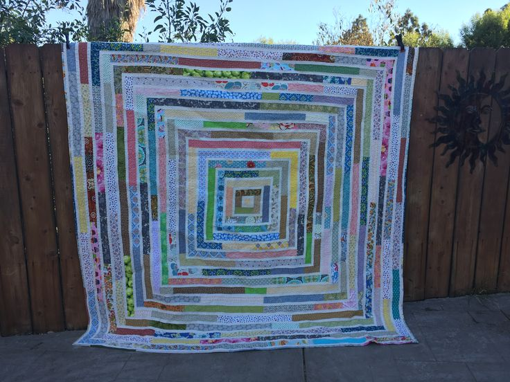 Queen size quilt made entirely out of scraps. I got dizzy creating this lol.