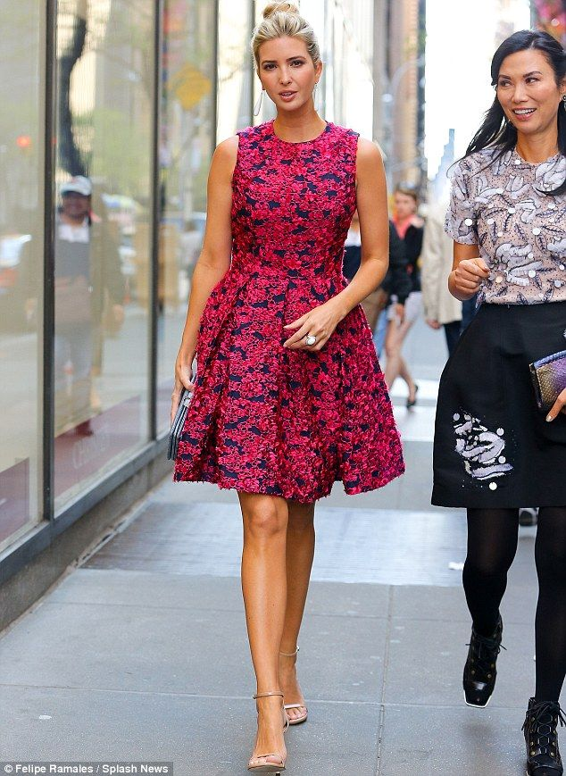 Showing her style: The 33-year-old former model looked great in a sleeveless pink frock...