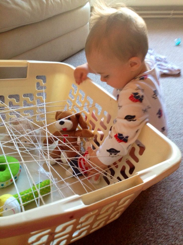 Spider's Web Discovery Basket. This is a great idea for fine motor, gross motor and thinking skills. You can make easy or more difficult to suit the skill level of your little one. Always supervise. Enjoy!