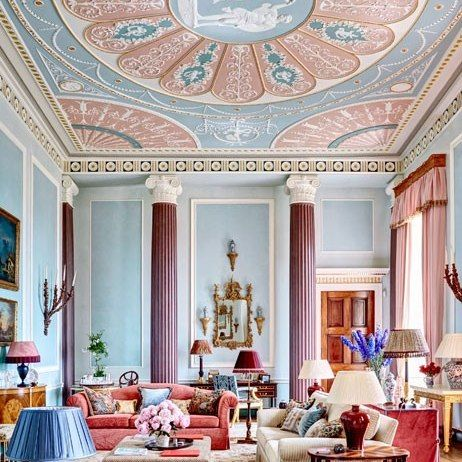 This stunning drawing room designed by Mark Gillette is distinguished by 16-foot columns and intricate plasterwork