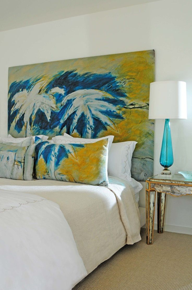 Charming tropical style bedroom design by Emily Summers Studio