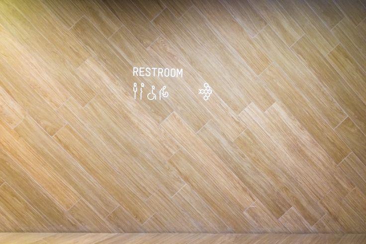 Hexagonal restroom sign