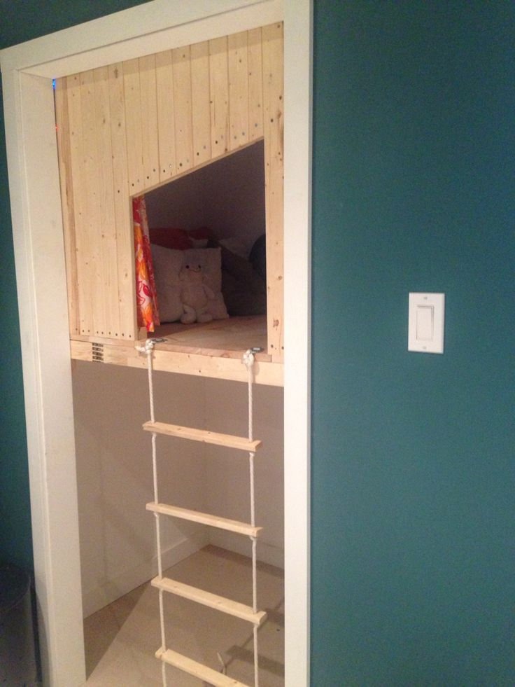 DIY indoor playhouse. Built into closet, lower section can be used as additional play area or for storage.