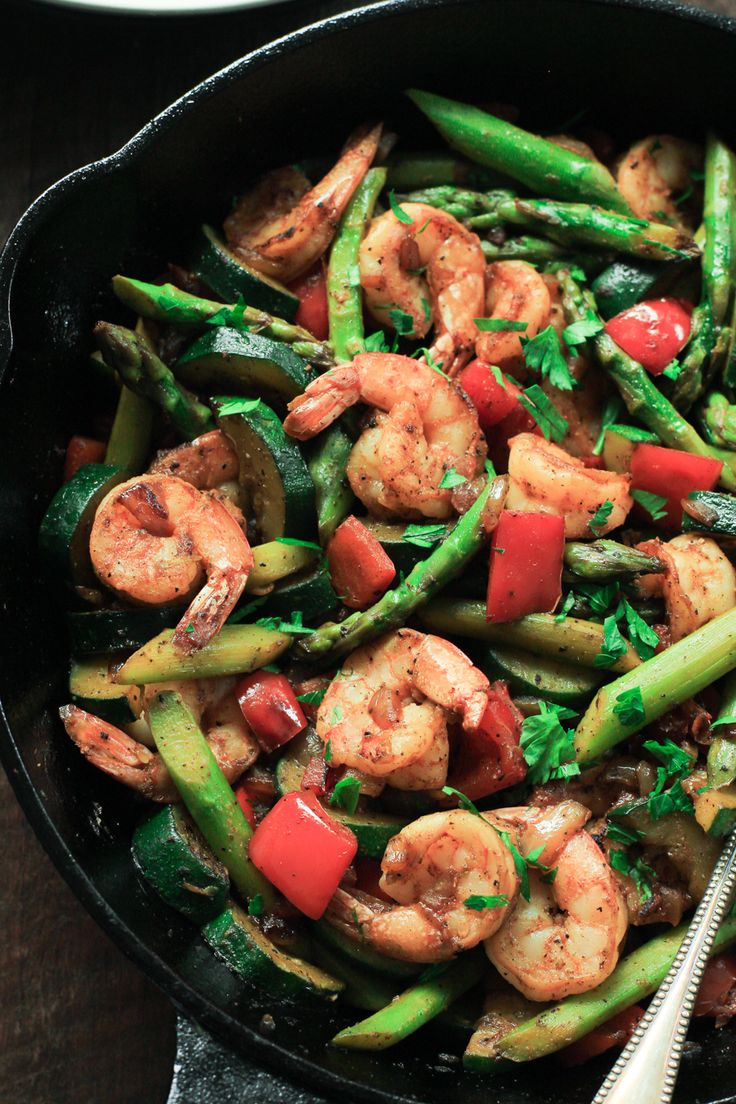 This ultra-easy Shrimp Vegetable Skillet recipe is loaded with veggies, flavorful spices and shrimp. It's a low-carb, gluten-free and paleo one-pan meal that is ready in less than 30 minutes. | www.primaverakitchen.com