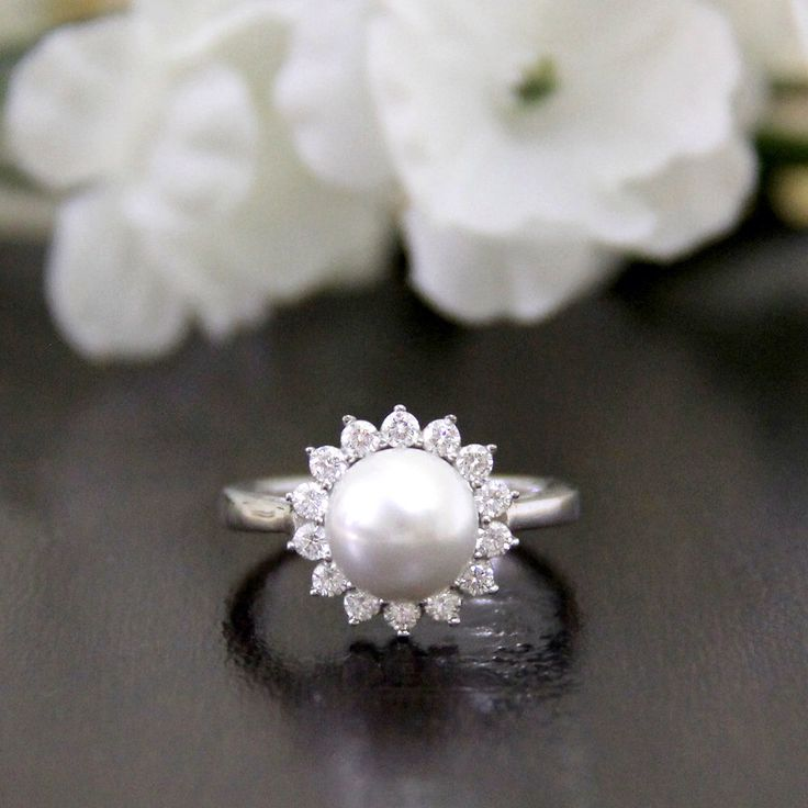 Pearl Ring-Pave Set Diamond Stimulants Halo Engagement Ring-Bridal Ring-Promise Ring-Anniversary Ring-Prom Ring-925 Sterling Silver-R80751 by Besbelle on Etsy https://www.etsy.com/listing/222567077/pearl-ring-pave-set-diamond-stimulants