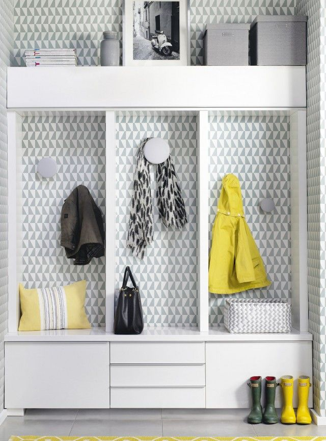 Bring a small grey space to life by covering it with patterned wallpaper like this little alcove. It looks smart and sophisticated, but most of all supplies some extra storage from an area that may have been unused otherwise.