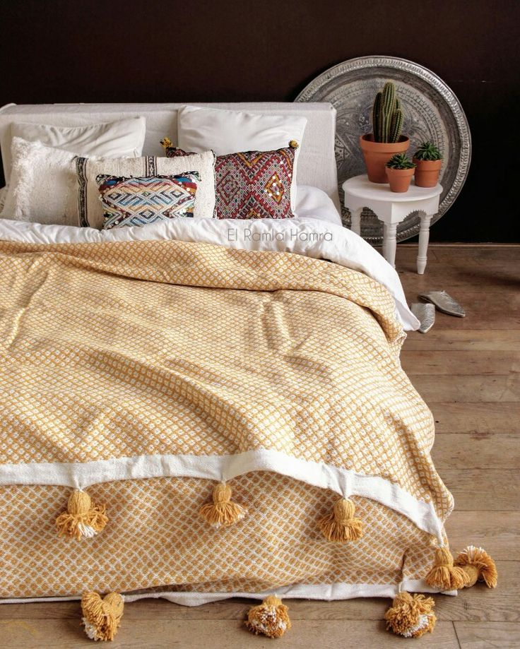 Beautiful bohochic handmade pompom blanket. www.elramlahamra.nl