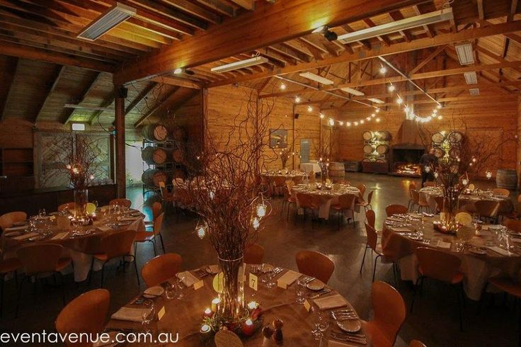 Modern Style Barn Wedding reception match with artistic table centerpieces
