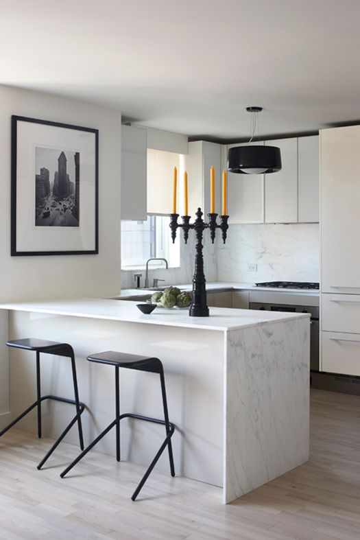 Kitchen Dreams. White marble waterfall island and that candelabra