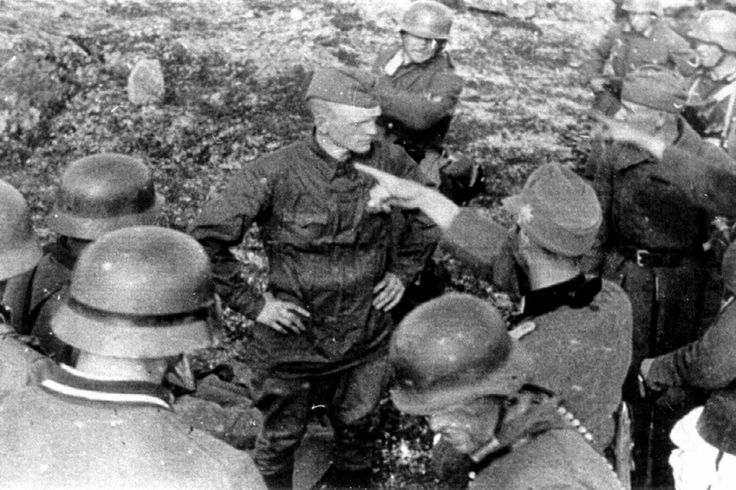 After the seizure of Hill 122 by 2nd Company/I.Battalion/ 136th Regiment two Soviet soldiers were captured by the weary soldiers. They are ordered by Obersleutnant Hans Wolf Rode to stand in front the rock formation behind them to be executed. Moments after this photo was taken, both were killed. The soldier in the long coat has been identified as private Sergey Korolkov, b.1912. The other man was most likely a junior officer, remains a mystery. The reasoning for the execution is unclear, a…