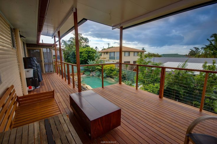 New outdoor entertaining area overlooking the pool in Manly West #deck #timberdeck #patio #patioroofing #patiodesign #DeKing Decking Calculator http://www.dekingdecks.com.au/decking-calculator/
