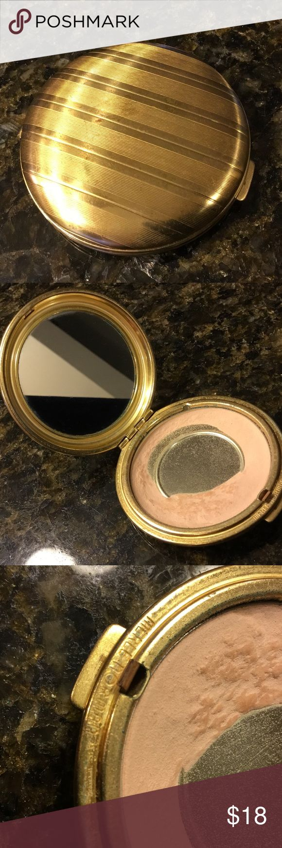 Vintage Gold Tone Compact with Mirror Vintage Merle Norman pressed powder compact with mirror. Used condition, shows age and wear. Mirror in good condition. Merle Norman Makeup