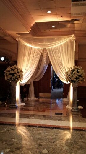 Wedding reception entrance. Maybe some fabric like this draped on either side of the door as you come in.