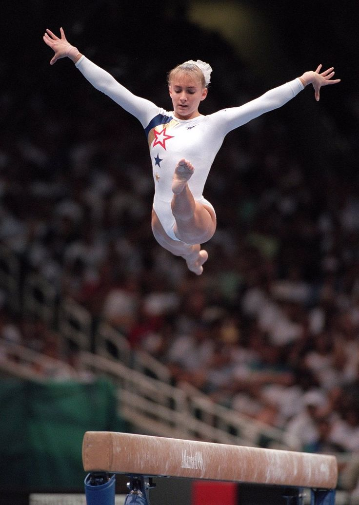 Shannon Miller of the U.S. women's gymnastic team flies high above the beam during her performance in the team competition at the Georgia Dome on July 21, 1996, during the 1996 Summer...