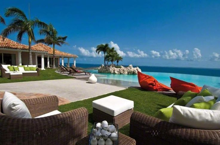 BELLE ETOILE http://www.stmaarteninvestments.com/real-estate.aspx?id_villa=162&type=sale&utm_source=Pinterest&utm_medium=web&utm_campaign=Magic+Bullet Terres Basses - French Lowlands, St. Martin 5 Bedrooms, 5.5 Bathrooms, Waterfront Featured is a huge shallow-entry heated pool with a Jacuzzi and a very large deck for sunbathing. The villa can be also rented for special occasions such as weddings and anniversaries.