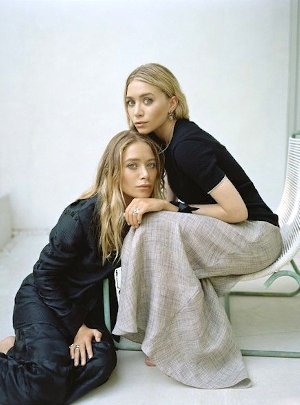 Photo via: Elle Love this new shot of Mary-Kate and Ashley in Elle December 2014. Get the look: + Eileen Fisher Long-Sleeve Button Down + Carolina Herrera Silk Maxi Skirt + Tamara Mellon Short Sleeve Sweater + Cremieux Soft Pleated Maxi Skirt