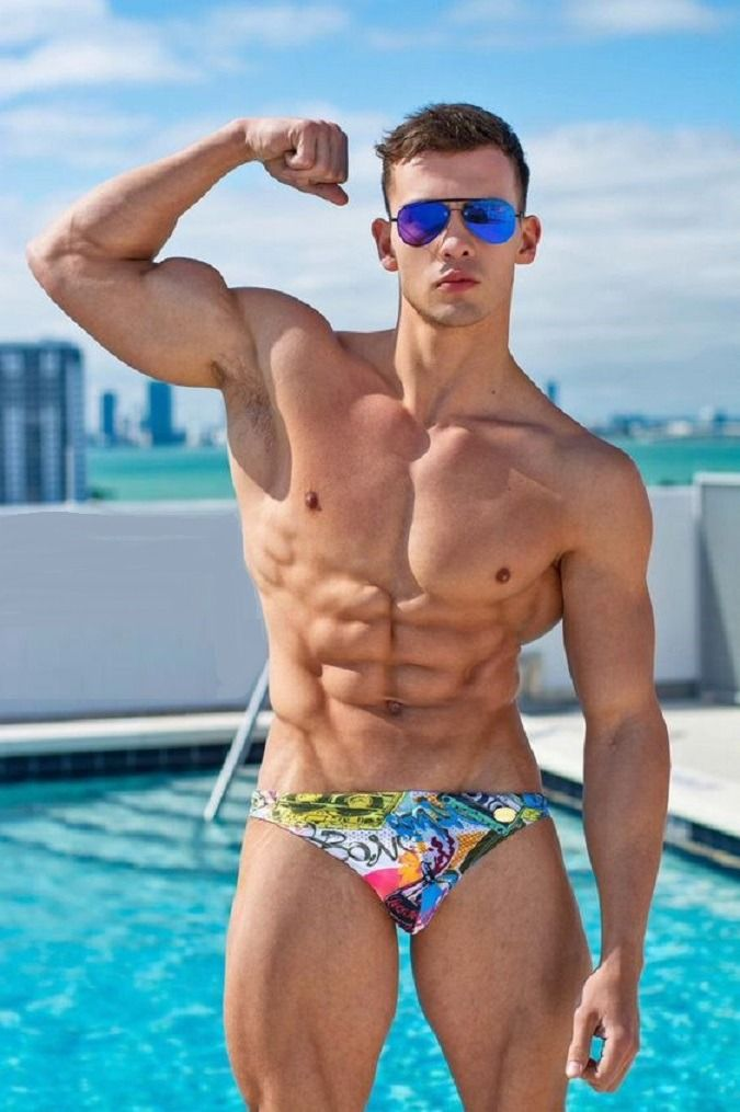 Male physique men swimming naked