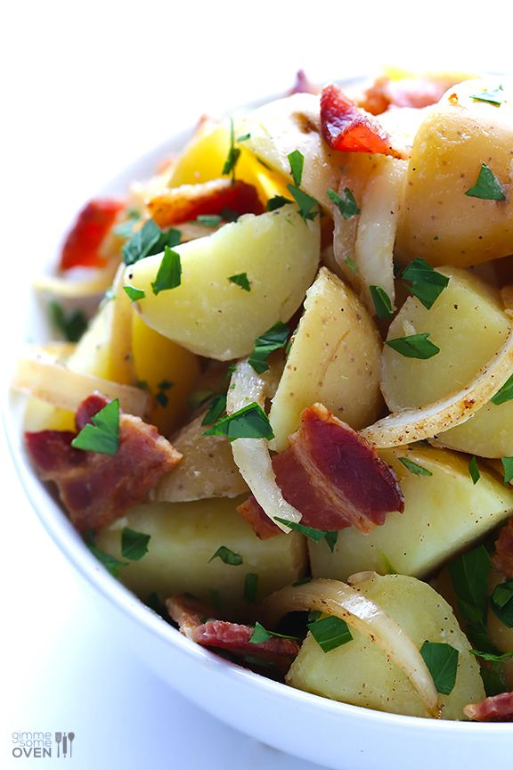 German Potato Salad -- this delicious and easy potato salad is tossed with bacon, onions and a light vinegar dressing | gimmesomeoven.com