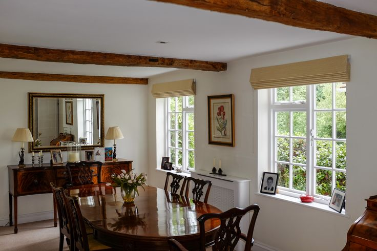 Country cottage dining room with some discrete Roman Blinds to finish it off. Bespoke Blinds by SauPing.