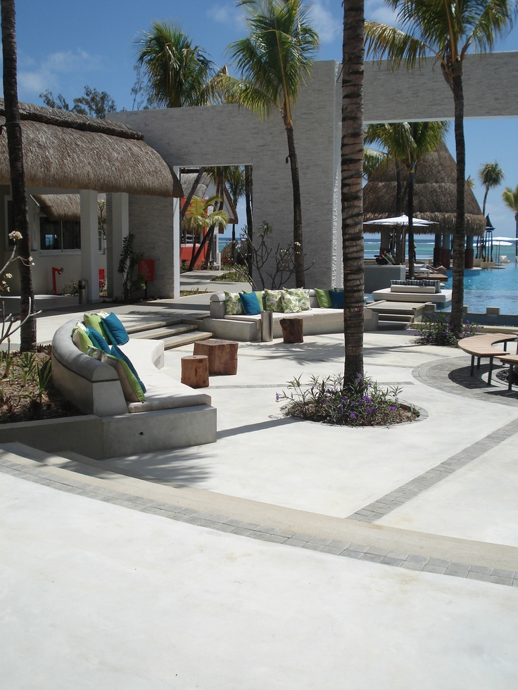 Cement Finishes applied for an Italian piazza at Ambre Hotel - Mauritius. The benches & Floors have been realized using Béton Ciré - Colour Hardener Light Grey, and finished smooth. #cement #floor #concrete #cemtech