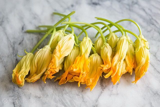 Have you ever eaten zucchini squash blossoms? They're so good! Terrific sautéed and served in a cheesy quesadilla. On SimplyRecipes.com