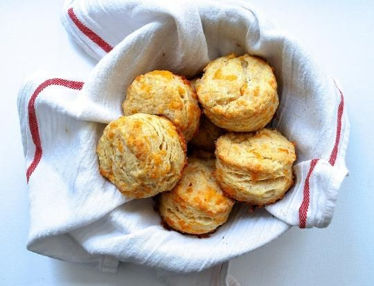 Today: Never say no to light, lofty, cheese-laced garlic biscuits. This buttery, flaky, garlicky biscuit is oozing with cheddar.