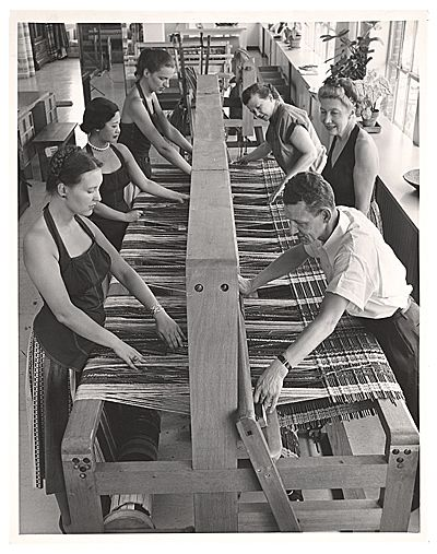 archivesofamericanart: There are a lot of things I like about this image: the lady on the left who came to the weaving studio with pearls on, the matching aprons that make those three women look like they're some kind of weaving dream team, and, of course, the super-loom that takes 5 people to operate.  Dorothy Liebes and weavers, 196-? / unidentified photographer. Dorothy Liebes papers, Archives of American Art, Smithsonian Institution.