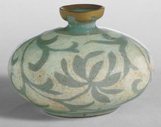 Oil bottle, Goryeo dynasty (918–1392), late 12th century Korea. Stoneware with reverse inlaid decoration of peonies under celadon glaze.