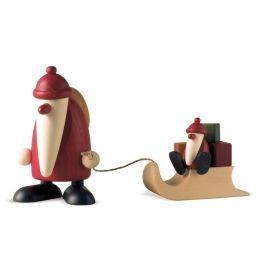 Père Noel décoratif et enfant sur luge