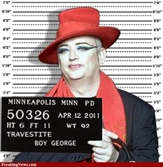 """Boy George wassentenced to 15 months in jail for falsely imprisoning a male escort by handcuffing him to a wall and beating him with a metal chain. The judge told the 47-year-old former Culture Club front man, whose real name is George O'Dowd, he had left the escort """"shocked, degraded and traumatised"""" by the ordeal. O'Dowd was found guilty last month of attacking the Norwegian model Audun Carlsen, 29, after he visited the singer's flat in London in April 2007."""
