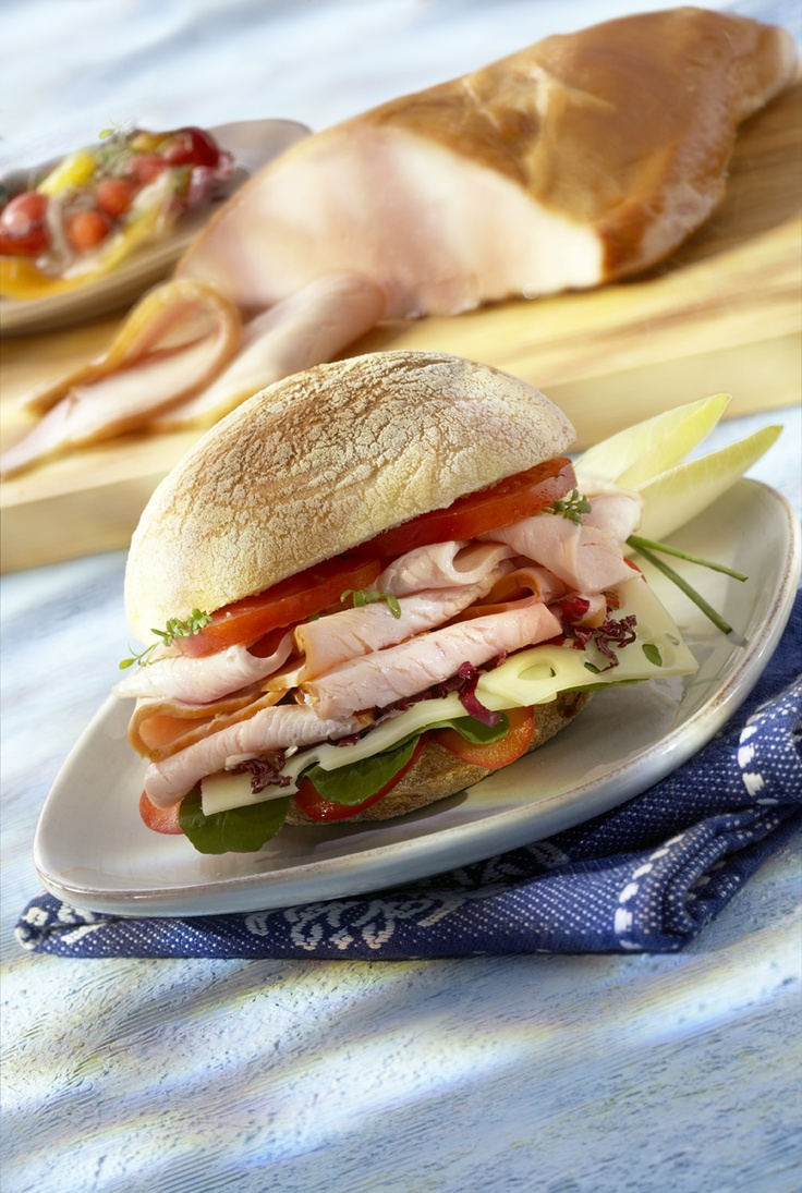 """A whole Turkey Breast in it's natural form. Slowly smoked with natural hard wood. Lean and delicious a wonderful addition to a sandwich or sliced thinly and rolled to top off a salad. At Brandt we put the """"deli"""" in delicious."""