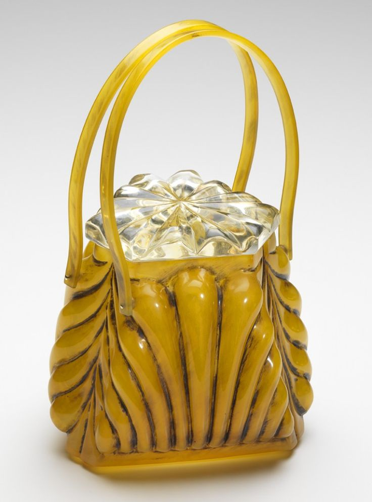 Llewellyn was known for its carved Lucite Lux® bags, as well as ones like this one made from shell, a hard plastic material composed of cellulose acetate.