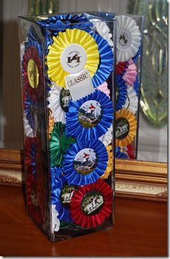 Show ribbon vase.. What a great idea for all those ribbons! mine are all hiding away in a box in the back of the closet! time to bring em out :)