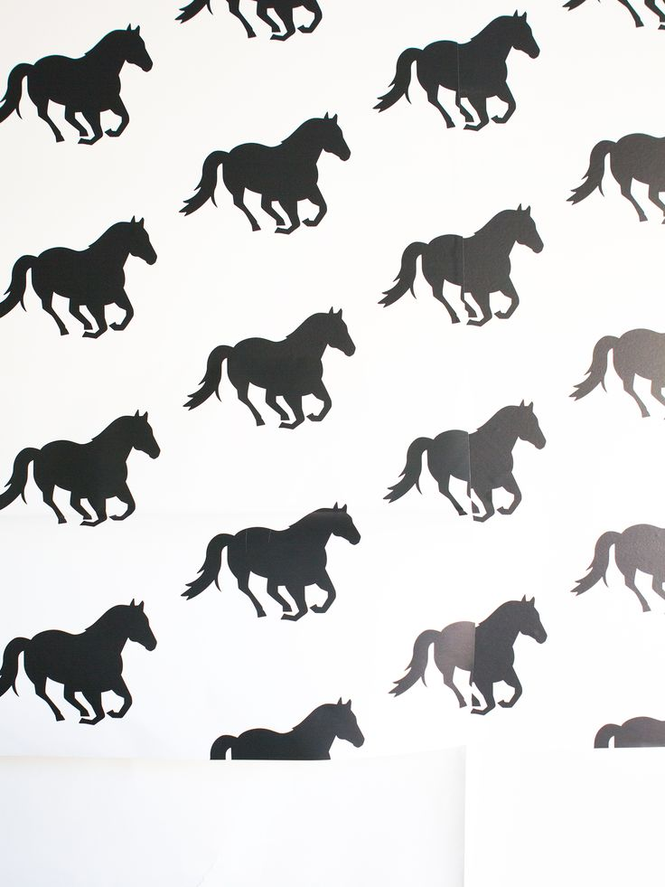 See how blogger Sarah Hearts gave her office a temporary update with a horse print peel and stick wallpaper! (Click through for tips and tricks on how to apply it) by Sarah Hearts