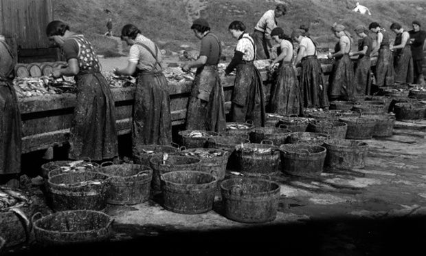 Herring girls gutting fish on the quayside, North Shields. Edwin Smith