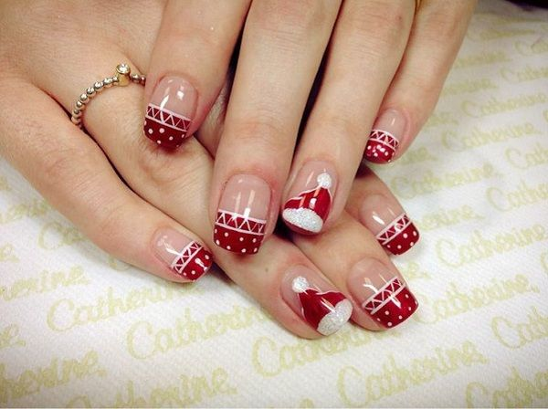 Creative and artsy looking French tips in red that you should try out. Paint Christmas hats and polka dots on your nail as French tips. The white and red combination is simply perfect for this style.