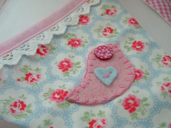 Sweet hand sewn bunting (banner).  Could be used to decorate booth too.
