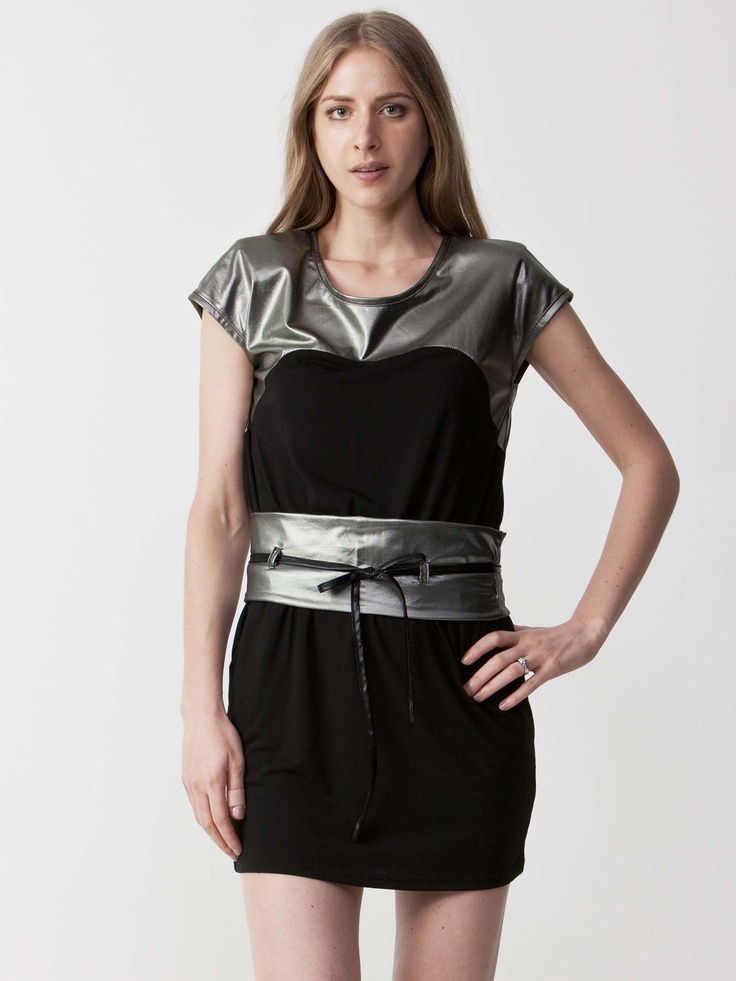 Videl - Metallic T-Shirt Dress with round neckline.  Lace tie waistline with asymmetric silver panels.  Regular fit cut and short sleeve styling. $60.50