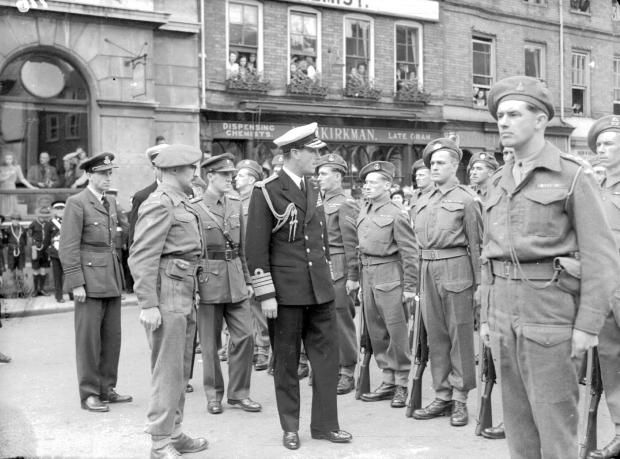 Lord Mountbatten inspects the guard of honour - THE personal flag of Lord Louis Mountbatten fluttered proudly over Romsey Town Hall sixty-nine years ago this week when the freedom of the ancient Borough was conferred on Romsey's most notable resident, Lord Louis Mountbatten.