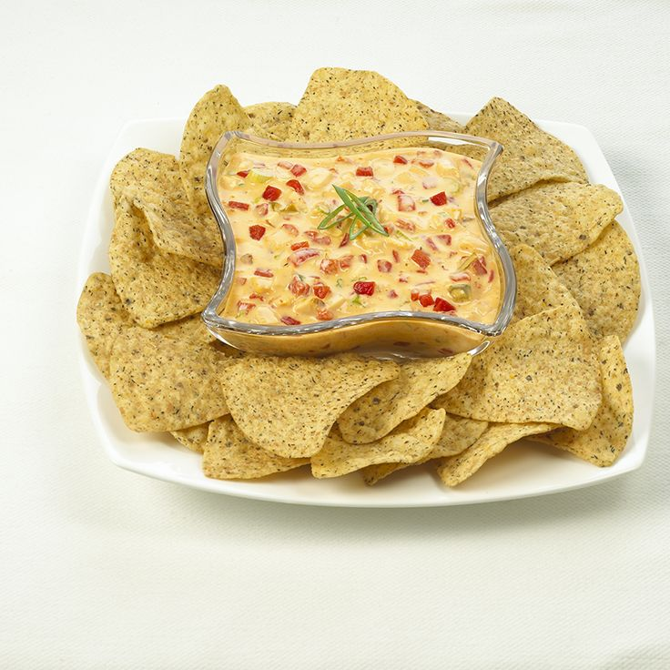 Roasted Red Pepper Cheesy Dip - Create the tastiest Roasted Red Pepper Cheesy Dip, Tostitos® own with step-by-step instructions. Make the best for any occasion.