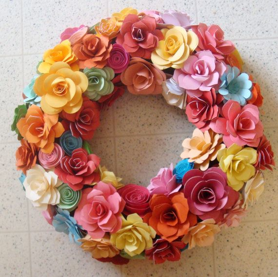 Paper Flower Wreath Beautiful colors in assorted open roses,assorted flowers rolled roses decorated wreath. you choose.... This listing is for a 12 to 13 inch ..mostly will be 13 inches around but flowers size may vary..I make it till its nice and round and full and lush with paper flowers Not for outside elements... I have left the back without flowers so it can lay flat against a wall...If you would like to hang it from a window I can add some to the back for another 20.00 Adorable for…