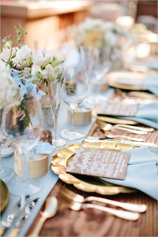 Light colors and bold metals work wonders in this gold and birds egg blue color scheme. A beautiful example of a tablescape to remember.