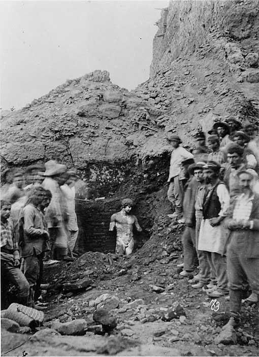 A figure from the past emerges. Antinous statue literally being discovered at Delphi in 1894.