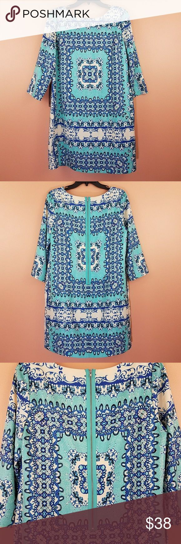 The Limited Shift Dress NWT shift dress from The Limited. Beautiful aqua base color, blue, black, and cream. Exposed zip back to add interest, 3/4 sleeve, flattering silhouette. 100% polyester. Size M. Approx measurements: 20in bust; 34in length. The Limited Dresses