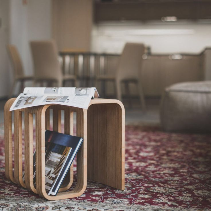 Check this out: Woodieful: A Chair, Magazine Holder and Side Table in One. https://re.dwnld.me/xVB3-woodieful-a-chair-magazine-holder-and-side-table-in-one