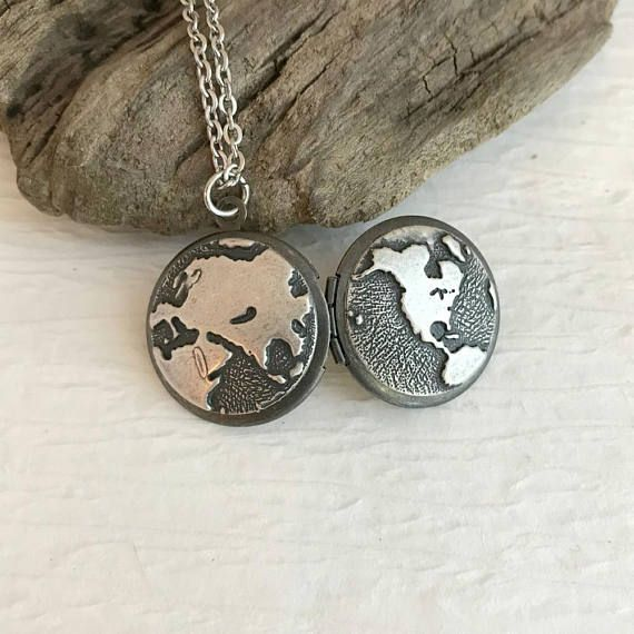 The small locket features both Eastern and Western Hemispheres of the earth--a lovely gift for a distant friend or relative or an avid traveler. The locket is a small size-- 20mm in diameter and opens for a secret place to keep pictures, messages, or whatever you like. It can hold two